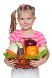Little girl holds a basket with vegetables Stock Photography
