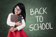 Little girl holds book back to school Stock Image