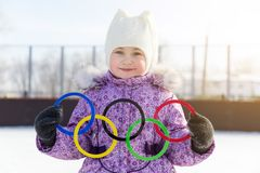 Russia, Yasny city, Orenburg region, school ice rink, 12-10. Olympic rings in the hands of a beautiful girl. A little girl holds five Olympic rings in her hands Royalty Free Stock Photography