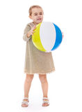 Little girl holds in front of an inflatable Stock Photography