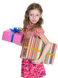Little girl holds gift boxes Stock Photo