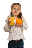 Little Girl Holds a Glass with an Orange Juice with One Hand and Stock Image