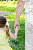 Little girl holds the hand of father Stock Photography