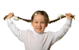 The little girl holds hands braids Stock Images