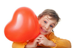 Little girl holds heart shape balloon isolated Stock Image