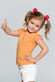 Little girl holds her thumb up Royalty Free Stock Image