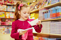 Little girl holds pack of envelopes Stock Image