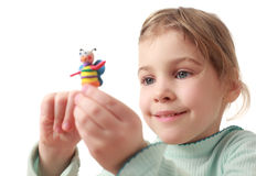 Little girl holds plasticine handmade sculpt Royalty Free Stock Photos