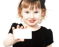 The little girl holds a pure card. In a hand Royalty Free Stock Images