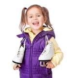 Little girl holds skates on white background Royalty Free Stock Photo