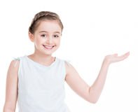 Little girl holds something on the arm Stock Image