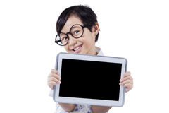 Little girl holds tablet with black screen Stock Photography