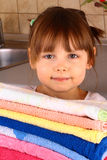A little girl holds towels after washing Royalty Free Stock Photography
