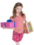 Little girl holds two gift boxes Stock Photo