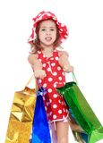 Little girl holds up a lot of big bright holiday Stock Photography