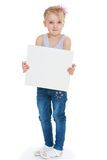 Little girl holds up a square piece of cardboard Royalty Free Stock Photos