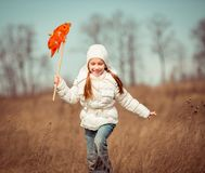 Little girl holds windmill in hand Stock Images