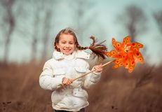 Little girl holds windmill in hand Royalty Free Stock Photography