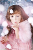 Little girl on holidays. Little girl holding a artificial snow Royalty Free Stock Photography