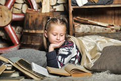 Little girl at home with a book Royalty Free Stock Images