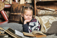 Little girl at home with a book Royalty Free Stock Photos