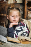 Little girl at home with a book Stock Image
