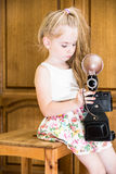 Little girl in home with camera. Little girl in dress with vintage camera Royalty Free Stock Photography