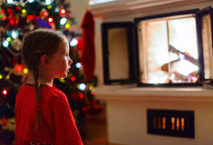 Little girl at home on Christmas eve Royalty Free Stock Photo