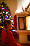 Little girl at home on Christmas eve Royalty Free Stock Photos