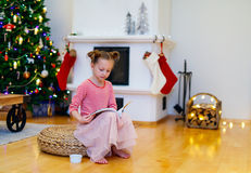 Little girl at home decorated for Christmas Stock Images