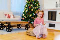Little girl at home decorated for Christmas Royalty Free Stock Photography