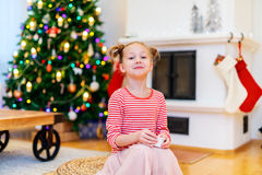 Little girl at home decorated for Christmas Stock Photos
