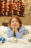 Little girl at home by the fireplace Royalty Free Stock Photo