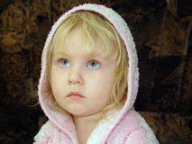 Little girl in a hood Stock Images