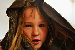 A little girl in hood. A little blond blue - eyed girl in brown hood Royalty Free Stock Photography
