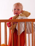 Little girl hoolding the teddy. Little girl stands in bed holding his teddy Royalty Free Stock Photos