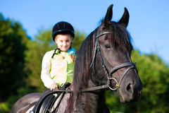 Little girl with horse Royalty Free Stock Photo
