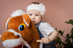 Little girl and horse. Child posing sitting on a horse Stock Photos
