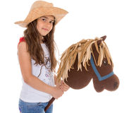 Little girl with a horse Stock Image