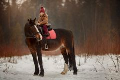 Little girl with horse outdoor portrait at spring day royalty free stock photos