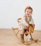 Little girl and horse - rocking chair Royalty Free Stock Image
