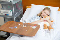 Little girl in hospital bed Royalty Free Stock Photo
