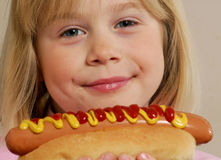 Little girl with hot dog Stock Photography