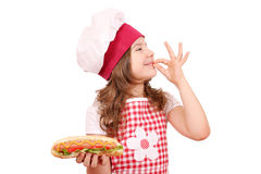 Little girl with hot dog and ok hand sign Royalty Free Stock Images
