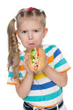 Little girl with hot dog Royalty Free Stock Photo