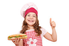 Little girl with hot dog and thumb up Royalty Free Stock Image