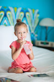 Little girl at hotel room Stock Photography