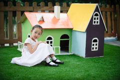 Little girl and house like Fairy tale Stock Image