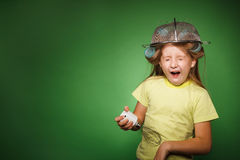 Little girl housewife with kitchenware play music Stock Photos