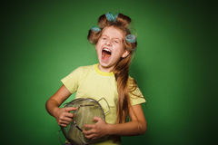 Little girl housewife with kitchenware play music Royalty Free Stock Image